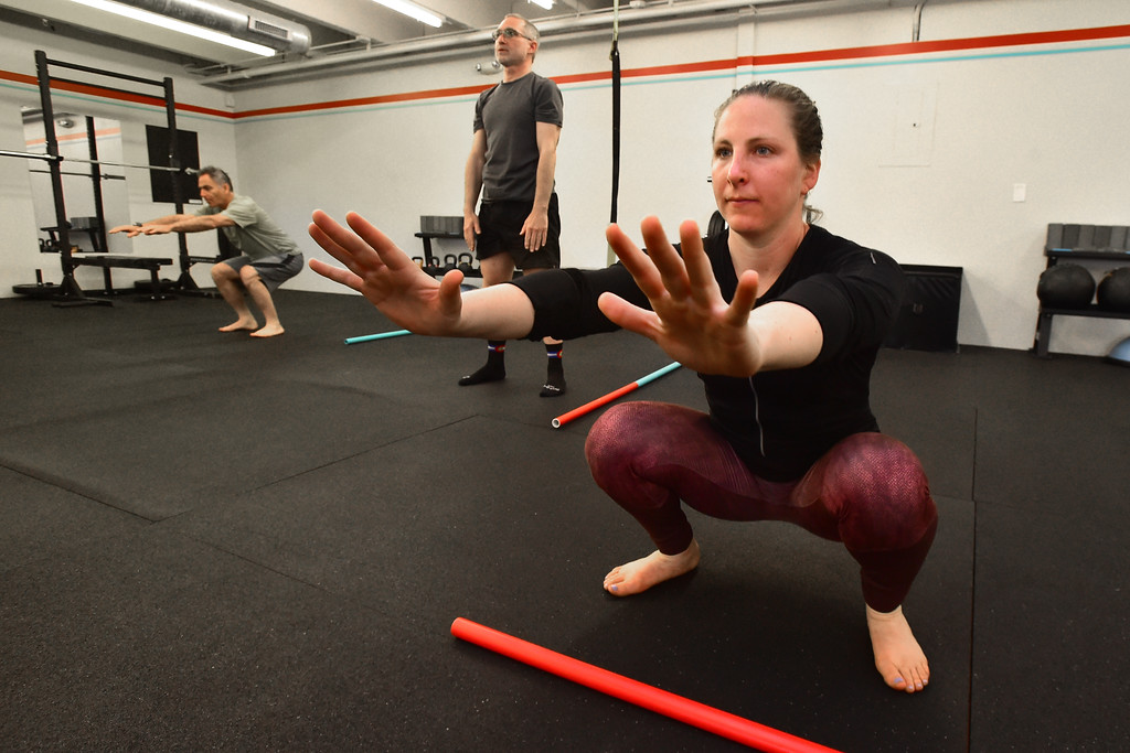 . Abby Maroko does deep squats in the warmup portion of the Future Proof Movement Mobility Class on Tuesday in Boulder. For more photos go to dailycamera.com Paul Aiken Staff Photographer April 10, 2018