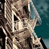 Vintage Fire Escapes in White Gold with Stormy Sky - Old Buildings and Architecture of New York City