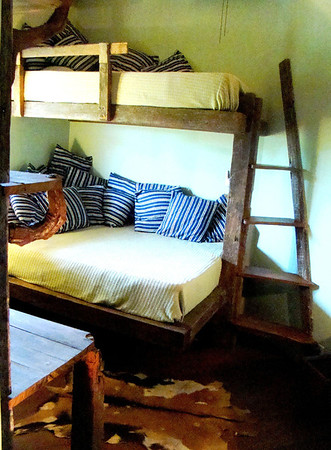 Second bedroom suite has a double bed and a single above for families. All made from reclaimed wood.