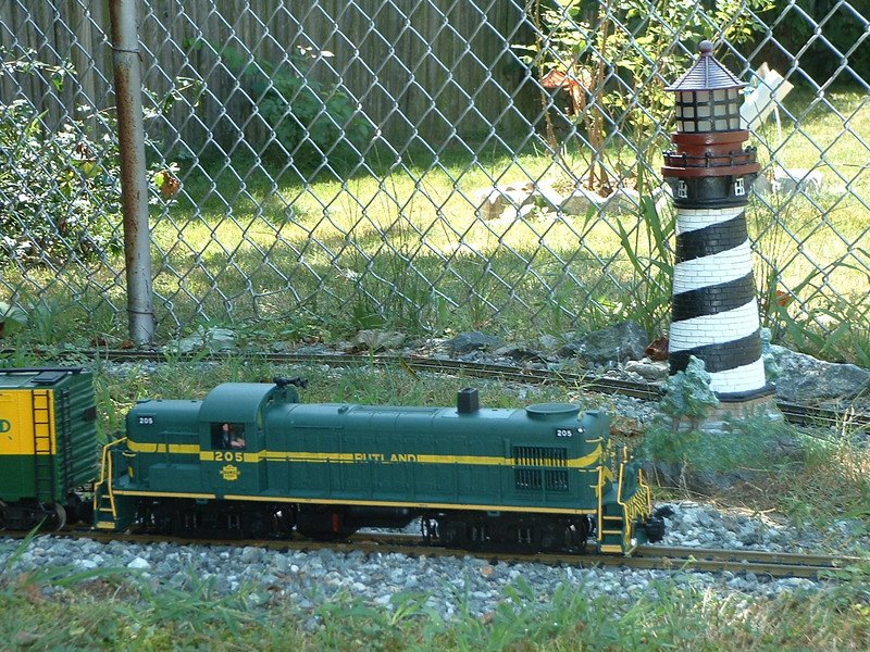 205 passes the lighthouse: Lighthouse point (lighthouse moved from seaside years ago to preserve} Lighthouse point overlooks the valley now. Home to freight conductor Harold.