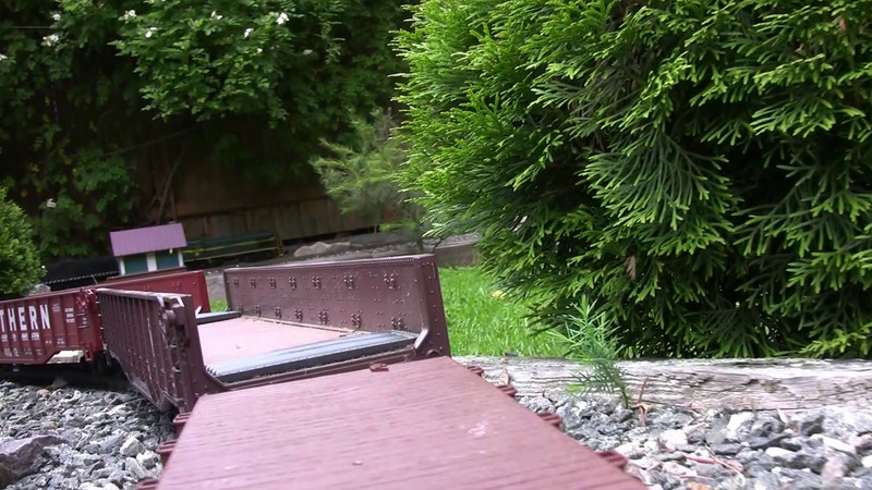 Your tour of the garden railroad, riding on a flatcar!