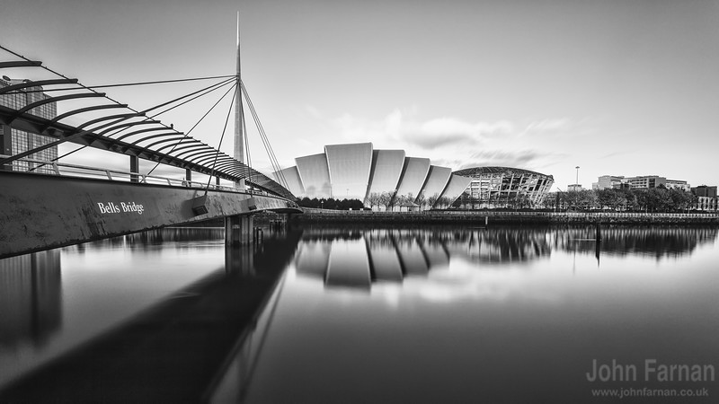 Armadillo and Bells bridge along Glasgows River Clyde. Not forgetting the Crowne Plaza hotel A Stunning Glasgow Print  Also available as a fine art canvas or wonderfully evocative acrylic print. Glasgow has never looked better  All images are printed just outside Glasgow and delivered anywhere in the world
