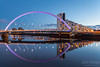 A Stunning Glasgow Print <br /> Also available as a fine art canvas or wonderfully evocative acrylic print.<br /> Glasgow has never looked better <br /> All images are printed just outside Glasgow and delivered anywhere in the world Clyde Arc in the morning sun. Stunning Glasgow image with a perfectly still Clyde River