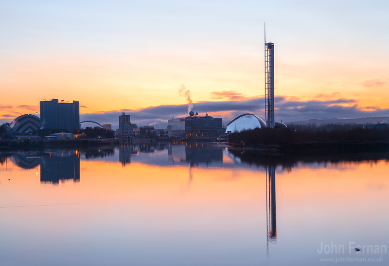 Glasgow City waterfront with The Clyde Auditorium  (the Armadillo), Crowne Plazal, Clyde Arc , STV building, BBC Scotland and the Science Centre. Not forgetting the Waverly docked up for the Winter in Glasgow.  Taken on Boxing Day morning on a perfectly still and calm day. Beautiful pastel colours from natures own morning glow. Even the Police helecopters so well known around Glasgow are on display and were being warmed up as i took this image.