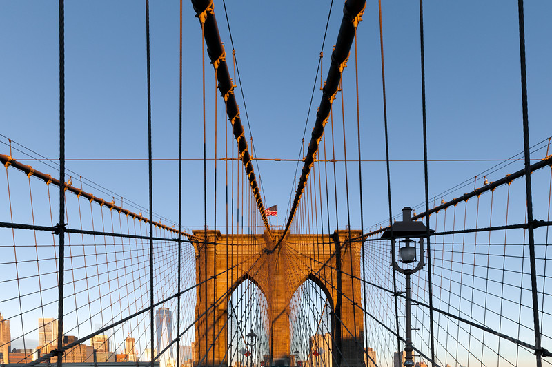 Brooklyn Bridge with one world trade center behind