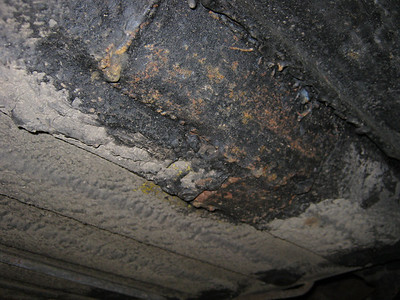 Poor welded patch over seatbelt mount area (LH). Will need removal and renewing inside and out.