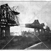 The Queensboro Bridge after the central truss was built over Roosevelt Island, and its arms were about to join bridge piers in Queens and Manhattan.
