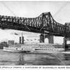An excursion steamer passing under the Queensboro Bridge.
