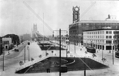 """Queens (or Bridge) Plaza, which contemporary papers referred to as """"a thing of beauty"""" and """"equal to the entrance to any park"""".  This tranquil scene was to change forever with the coming of the elevated subway station at Queensboro Plaza in 1915.  (Note the flagpole from perennial America Cup competitor Sir Thomas Lipton's yacht at the center of the photo; it was there only from 1912 to 1914.)"""