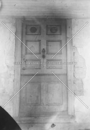 Door of the Jacob Blackwell house, c. before 1700 Was at foot of 37th Avenue, Ravenswood.  Note the arrow hacked by Redcoats with saber in 1776. (The door is on permanent display at the Greater Astoria Historical Society.)