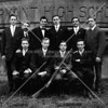 Bryant High School gun team.  Team captain Ira Terwilliger holds the gun.  Teacher and advisor is Mr. Lowry (back row, second from left)