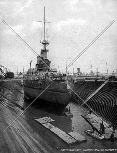 Depiction of the Brooklyn Navy Yard with one of its works near completion.