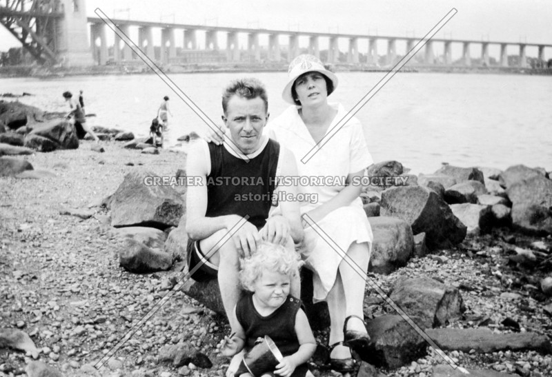 William H. Rydberg, his wife Elvira, and daughter Ruth c. 1926.  Virtually unheard of today, swimming in the East River to wile away summer afternoons was a typical mode of recreation for Astorians back then.  The Hell Gate Bridge viaduct on Wards Island is in the background.