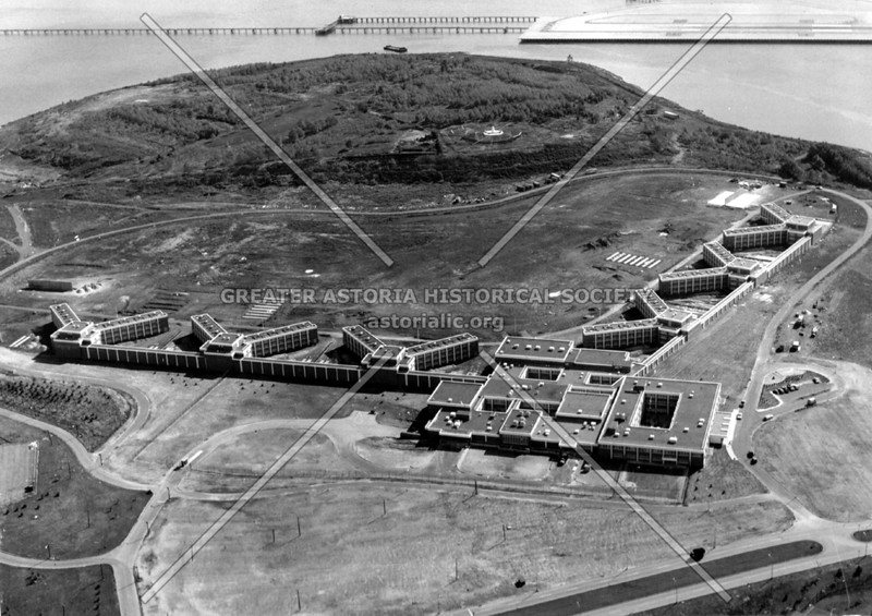 Adolescent Reception and Detention Center, which opened in 1972, capacity of 2,500.  Note the end of a LaGuardia Airport runway in the background.