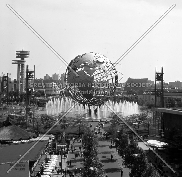 The Unisphere, overarching symbol of the 1964-65 World's Fair, seen here rising triumphantly amid water fountains at full spray.