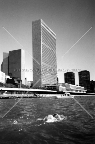 An intrepid swimmer bravely competing in the 2004 Manhattan Island Marathon Swim passing the United Nations.