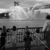 Fireboat salute on East River.  What a sight it must have been for the children here to behold!