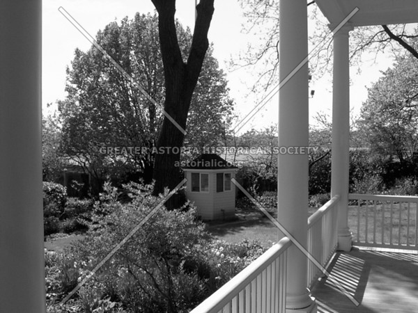 Tranquil setting of Gracie Mansion, official residence of New York City mayors, sitting alongside the East River