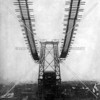 Dramatic view of the Williamsburg Bridge during an early phase of its construction