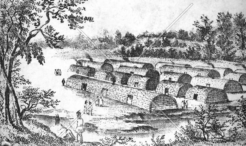 Bark-covered native longhouses in New York area before European settlement.