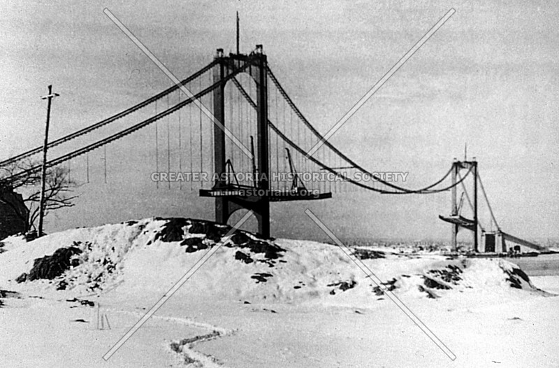 An view of the Bronx-Whitestone Bridge in an early stage of construction.  It was completed in just 23 months, in 1939, to the price of $17 million.