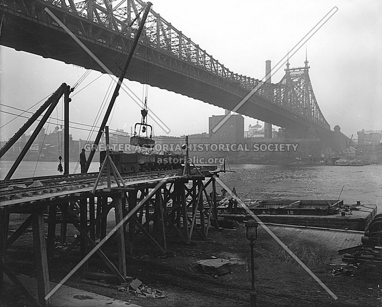 A gritty, industrial view of the Queensboro Bridge