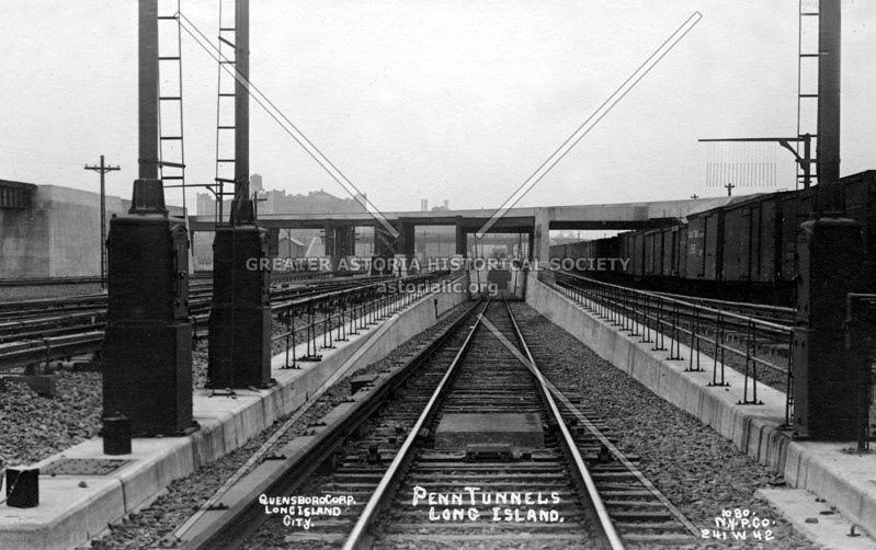 Railroad tunnels first opened on September 8, 1910, and were to go under the East River from Hunters Point to midtown Manhattan.   This is a view of one of the newly opened railroad tunnel entrances in Queens