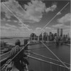 One of bridge photographer Dave Frieder's many dramatic shots, here from the top of the Manhattan Bridge in the late 1990s.  (Such activity has been banned in the wake of 9/11.)