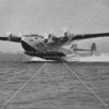 Action photo of a Pan American Airways transatlantic clipper taking off from Bowery Bay at LaGuardia Airport (c.1940)