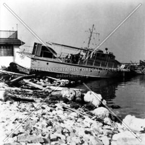 "The 1938 Long Island hurricane dislodged fishing boat ""Atlantis"" at Muff's Boatyard in northern Astoria."