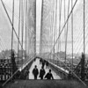 Early view of the pedestrian walkway on the Brooklyn Bridge, a triumph of function and beauty.