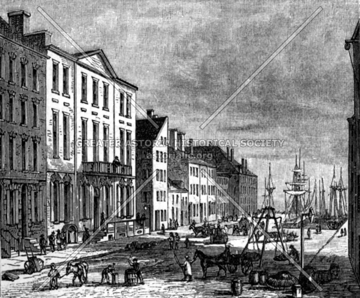 """Depiction of the Tontine Coffee House that first opened in the 1790s at the corner of Wall and Water Streets.  (As legend would have it, this financial activities taking root in this area would ultimately render it as the """"birthplace"""" of Wall Street.)"""