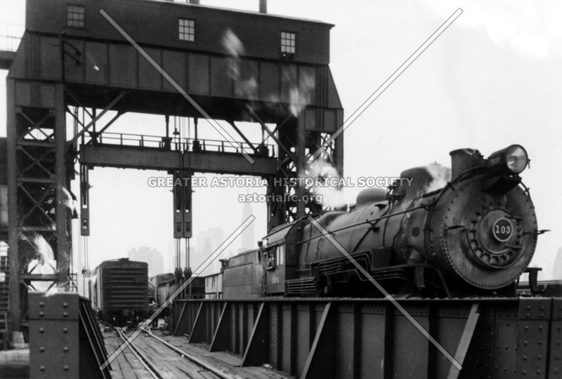 Gantries, or float bridges, at Hunters Point terminal at the East River.  Gantries helped guide and lift railroad cars.