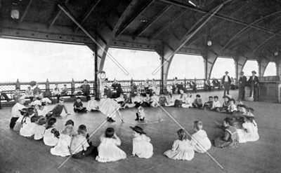 Antique image of a kindergarten class meeting on a new recreation pier on 24th Street (formerly Wolsey Avenue), just north of what was once the notorious Gas House District.