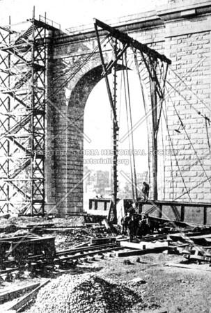 A close view of a masonry pier.