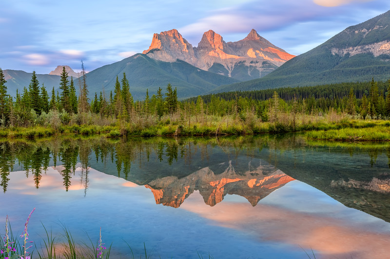 Three Sisters reflection in Policeman's Creek in Canmore, Alberta