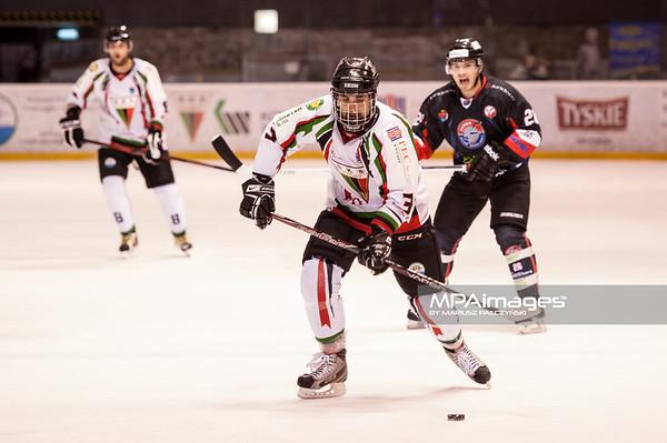 26.11.2013 , Tychy , Stadion Zimowy , hokej , Polska Hokej Liga , GKS Tychy (biale) Ciarko PBS Bank Sanok (czarne)  N/Z Adam Baginski Fot. Karol Bartnik / MPAimages.com