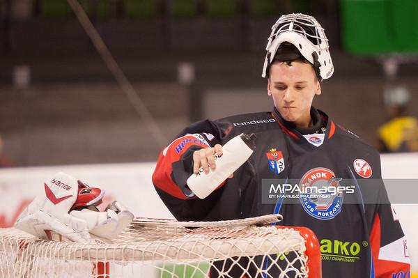 26.11.2013 , Tychy , Stadion Zimowy , hokej , Polska Hokej Liga , GKS Tychy (biale) Ciarko PBS Bank Sanok (czarne)  N/Z Mateusz Skarabalak Fot. Karol Bartnik / MPAimages.com