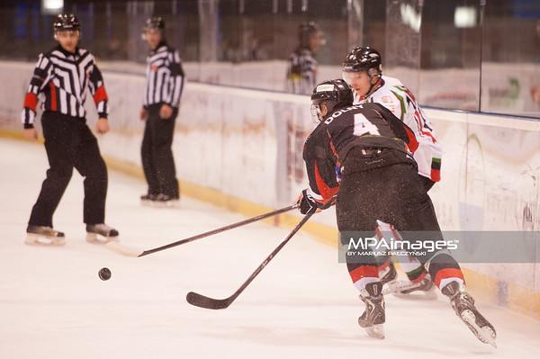 26.11.2013 , Tychy , Stadion Zimowy , hokej , Polska Hokej Liga , GKS Tychy (biale) Ciarko PBS Bank Sanok (czarne)  N/Z Kamil Dolny Fot. Karol Bartnik / MPAimages.com