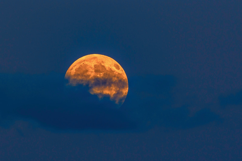 Moon emerging from clouds