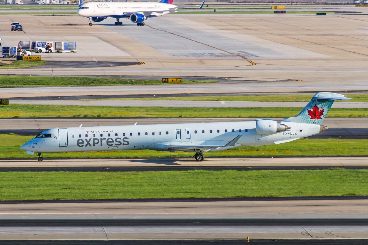 Air Canada Express Jazz Airlines, C-FUJZ, CRJ-705, msn 15048, Photo by John A Miller, ATL, Image YE004LGJM