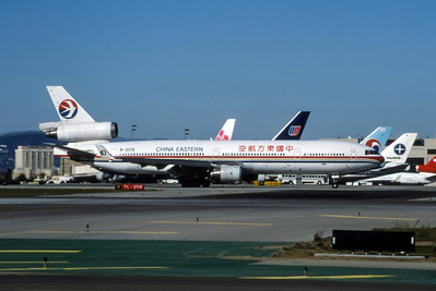 China Eastern, B-2175, McDonnell Douglas MD-11, msn 48520, Photo by Brian Peters, LAX, Image II12RGBP