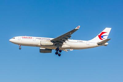 China Eastern, B-5962, Airbus A330-243, msn 1588, Photo by John A Miller, LAX, Image WA006LAJM