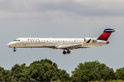 Delta Connection, N659CA, CRJ-700, msn 10153, Photo by John A Miller, TPA, Image YE005LAJM