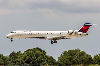 Delta Connection, N659CA, CRJ-700, msn 10153, Photo by John A Miller, TPA, Image YE005LAJM