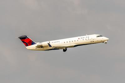 Delta Connection (Comair), N973CA, CRJ-100ER, msn 7146, Photo by John A Miller, TPA, Image YY018RAJM