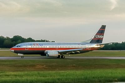 USAir, N503AU, Boeing 737-3B7, msn 23378, Photo by John A Miller, GSO, Image K028LGJM