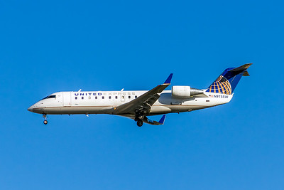 United Express, N975SW, CL-600-2B19 Regional Jet CRJ-200ER, msn 7951, Photo by John A Miller, LAX, Image YY019LAJM, Operated by Sky West Airlines