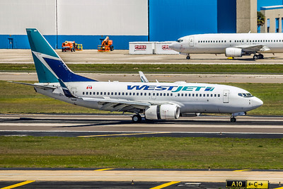 WestJet Airlines, C-FWBW, Boeing 737-7CT(WL), msn 33697, Photo by John A Miller, TPA, Image T069RGJM
