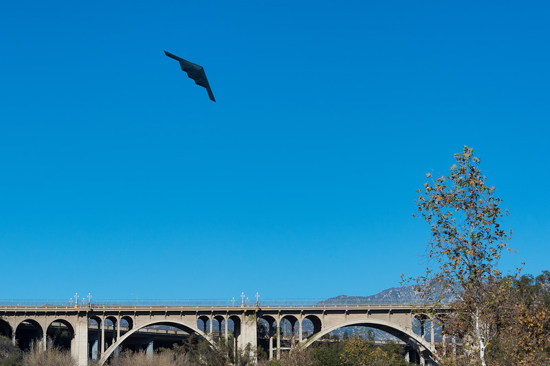 The B2 stealth bomber flies over Colorado Street Bridge in Pasadena before the Rose Bowl game on Jan. 1, 2019.